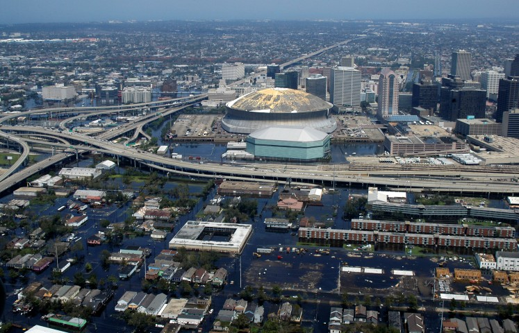 050831-N-8154G-115 New Orleans, La. (Aug 31, 2005) Ð Aerial view from a U.S. Navy helicopter assigned to Helicopter Sea Combat Squadron Two Eight (HSC-28), showing the rising flood waters threatening the entire downtown New Orleans city center, including the famed New Orleans Saints Super Dome.  Tens of thousands of displaced citizens sought shelter at the dome, before, during and after Hurricane Katrina, but have been forced to evacuate as flood waters continue to rise throughout the area. HSC-28 flies the MH-60S Seahawk variant, based out of Norfolk, Va., and is embarked aboard the amphibious assault ship USS Bataan (LHD 5) participating in humanitarian assistance operations led by the Department of Defense, in conjunction with the Federal Emergency Management Agency (FEMA). Bataan has been tasked to be the Maritime Disaster Relief Coordinator for the NavyÕs role in the relief efforts. U.S. Navy photo by Photographer's Mate Airman Jeremy L. Grisham (RELEASED)